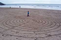 Alicia walks a Celtic labyrinth, made on a beach in Wales.